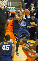 West Virginia Mountaineers guard Jevon Carter (2) tries to draw a foul against the Oklahoma State Cowboys during the second half at the WVU Coliseum.