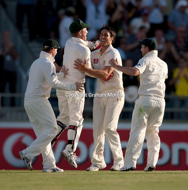 Mitchell Johnson (centre) celebrates taking the wicket of Jonathan Trott during the third Ashes test match between Australia and England at the WACA (West Australian Cricket Association) ground in Perth, Australia. Photo: Graham Morris (Tel: +44(0)20 8969 4192 Email: sales@cricketpix.com) 18/12/10