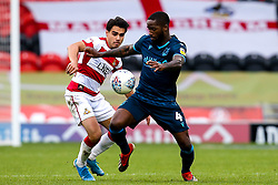 Abu Ogogo of Bristol Rovers takes on Reece James of Doncaster Rovers - Mandatory by-line: Robbie Stephenson/JMP - 19/10/2019 - FOOTBALL - The Keepmoat Stadium - Doncaster, England - Doncaster Rovers v Bristol Rovers - Sky Bet League One