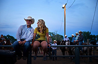 Sweethearts Bryce Dibbern of Amherst, Neb., and Tylee Coffman of Dunning, Neb., perch on a fence to catch a view of the team roping during Nebraska's Big Rodeo on Saturday, July 27, 2013. &quot;This may be a small town, but it's got a big rodeo, and it's got a really big heart,&quot; 2013 Miss Burwell Rodeo Olivia Hunsperger said. In its 92nd year, the rodeo continues strong and serves as an economic stronghold for a small community in the Sandhills of Nebraska.   On assignment for the Omaha World-HeraldBu<br /> <br /> Chicago Freelance Documentary Photographer   Alyssa Schukar   Photojournalist