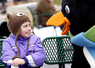 Haley Krogman, 9 of Covington, Ohio gets a visit from  Parker the Penquin during a session with the ice rink's mascot at the RiverScape MetroPark in downtown Dayton, Sunday, January 22, 2012.