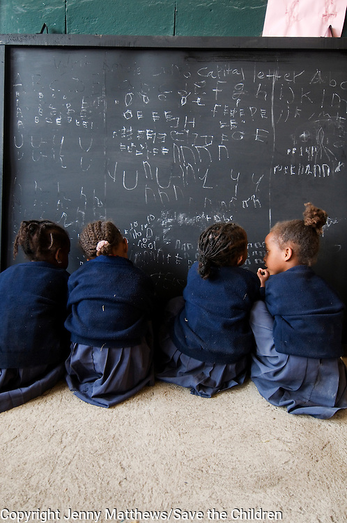 Ethiopia 2008. Addis Ababa &ndash; Karakore township<br /> Five year old girls practise writing on the blackboard.