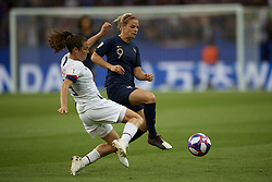 June 28, 2019 - Paris, France - Kelley O Hara (Utah Royals FC) of United States and Eugenie Le Sommer (Olympique Lyon) of France competes for the ball during the 2019 FIFA Women's World Cup France Quarter Final match between France and USA at Parc des Princes on June 28, 2019 in Paris, France. (Credit Image: © Jose Breton/NurPhoto via ZUMA Press)