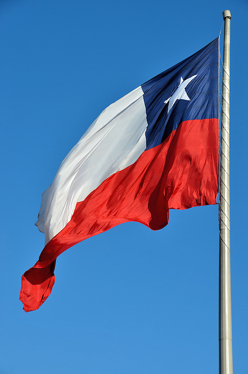 Chilean Flag Flying in Santiago, Chile<br /> La Estrella Solitaria or The Lone Star is the proud symbol on the Chilean flag. Approximately 18 million people live in the Rep&uacute;blica de Chile which stretches about 4,000 miles along the Pacific Ocean. After being ruled by Spain from 1540 until its independence in 1818, the country experienced some challenging governments until their transition to democracy in 1990. Today it enjoys one of the best economies and living standards in Latin America.
