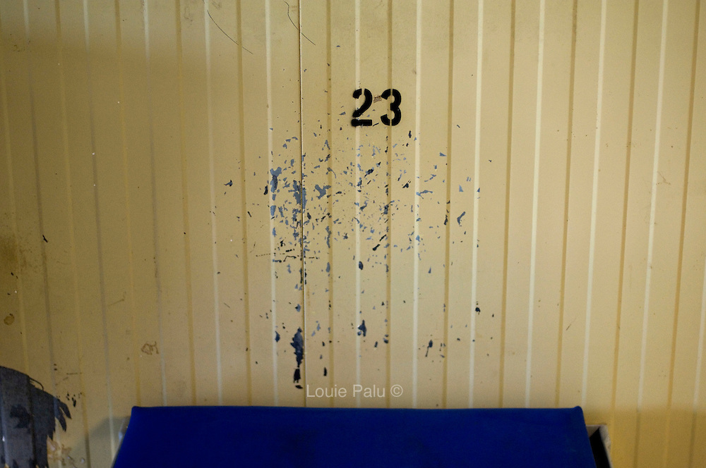 "Peeled and chipped paint on a wall above a detainee's bed in Camp 4 at the detention facility in Guantanamo Bay, Cuba. Approximately 250 ""unlawful enemy combatants"" captured since the September 11, attacks on the United States continue to be held at the detention facility.(Image reviewed by military official prior to transmission)"