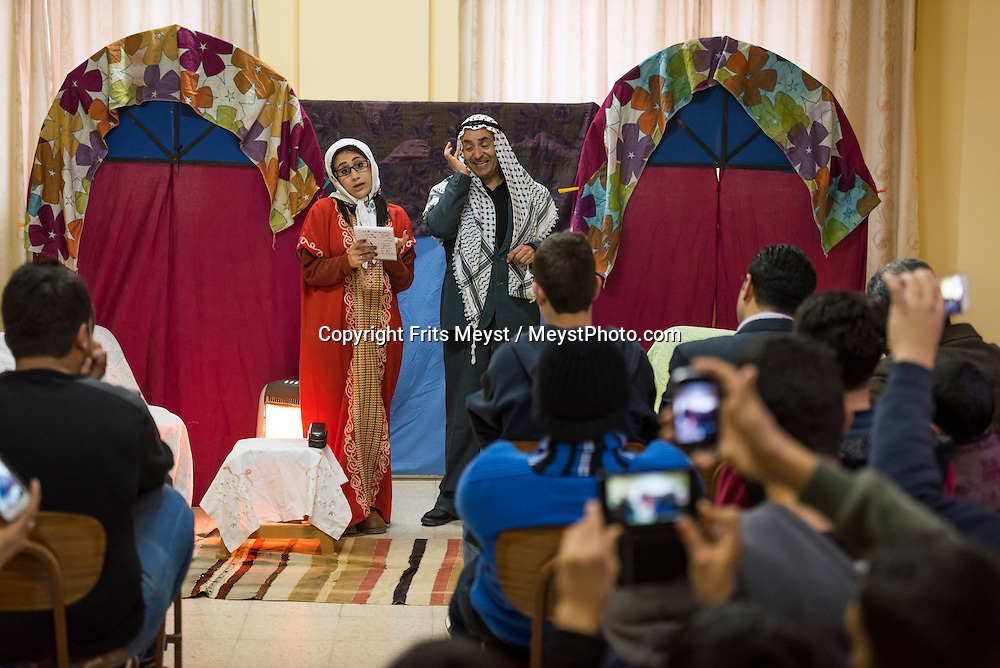Palestine, March 2015. A Local play for children about the Abraham Path, Masar Ibrahim. Sebastia offers thousands of years of local history. The town is built on the site of the biblical city of Samaria. Atop the archaeological hill, surrounded by Roman ruins, a Greek Orthodox church marks the site associated with the discovery of John's head. The Abraham Path is a long-distance walking trail across the Middle East which connects the sites visited by the patriarch Abraham. The trail passes through sites of Abrahamic history, varied landscapes, and a myriad of communities of different faiths and cultures, which reflect the rich diversity of the Middle East. Photo by Frits Meyst / MeystPhoto.com for AbrahamPath.org
