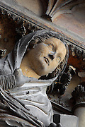 Low angle view of Elysabeth (cousin of Virgin Mary), annunciation group, right jamb statues of the central portal of the western facade of Notre-Dame de Reims (Our Lady of Rheims), pictured on February 15, 2009, 13th - 15th century, Roman Catholic Cathedral where the kings of France were crowned, Reims, Champagne-Ardenne, France.