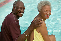 Senior Couple Relaxing Poolside