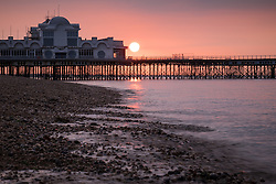 © Licensed to London News Pictures. 15/09/2016. Portsmouth, UK.  Dawn breaks as the sun rises over South Parade Pier in Southsea this morning, 15th September 2016. Photo credit: Rob Arnold/LNP