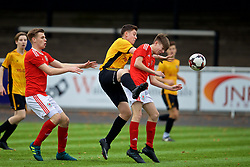 MERTHYR TYDFIL, WALES - Thursday, November 2, 2017: Wales' Rob Reynolds, Newport County's Oliver Stone and Wales' Charlie Williams during an Under-18 Academy Representative Friendly match between Wales and Newport County at Penydarren Park. (Pic by David Rawcliffe/Propaganda)