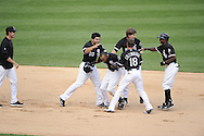 CHICAGO - JULY 09:  Teammates surround Alexei Ramirez #10 of the Chicago White Sox in celebration after Ramirez drove in the game winning run in the bottom of the ninth inning against the Minnesota Twins on July 9, 2011 at U.S. Cellular Field in Chicago, Illinois.  The White Sox defeated the Twins 4-3.  (Photo by Ron Vesely)  Subject: Alexei Ramirez