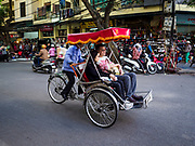 21 DECEMBER 2017 - HANOI, VIETNAM:  A pedicab takes tourists from Asia on a tour of Hanoi in the old quarter of the Vietnamese capital.  PHOTO BY JACK KURTZ