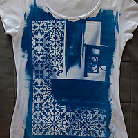 Exquisite blue over white handmade t-shirt with an image of Lisbon's iconic street  details with tiles.<br />