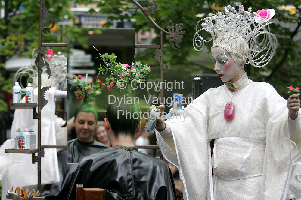 "11/8/2004.""Osadia"" from a Spanish street animation company pictured creating free psychedelic hairdos at the Market Cross Shopping Centre at the Kilkenny Arts Festival yesterday..Picture Dylan Vaughan"