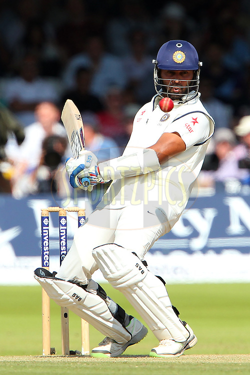 Murali Vijay of India avoids a bouncer from James Anderson of England during day three of the 2nd Investec test match between England and India held at Lords cricket ground in London, England on the 19th July 2014<br /> <br /> Photo by Ron Gaunt / SPORTZPICS/ BCCI