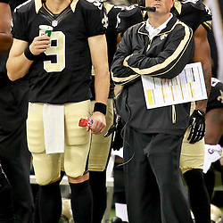 August 25, 2012; New Orleans, LA, USA; New Orleans Saints quarterback Drew Brees (9) and offensive coordinator Pete Carmichael during the second half of a preseason game against the Houston Texans at the Mercedes-Benz Superdome. The Saints defeated the Texans 34-27.  Mandatory Credit: Derick E. Hingle-US PRESSWIRE