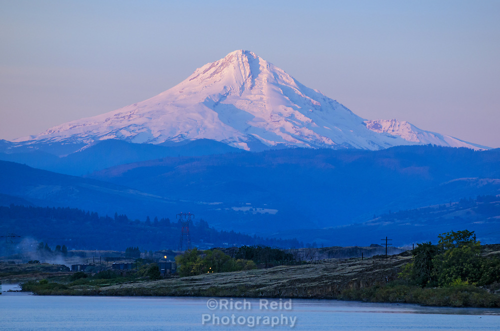 Mount Hood and the Columbia River at The Dalles Dam and Lock in Oregon.
