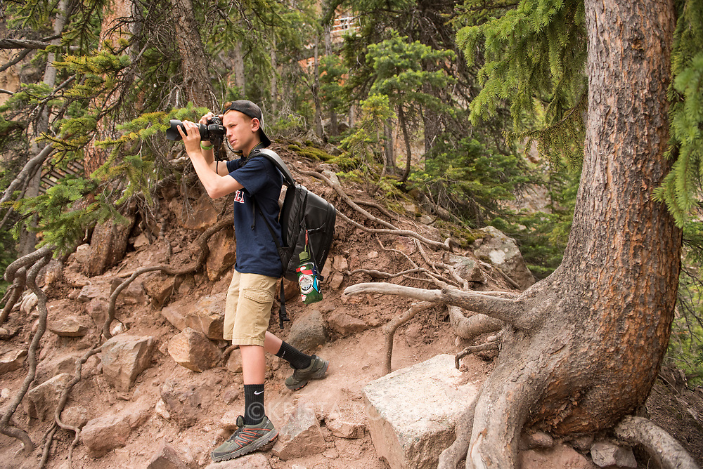 National Geographic Student Expeditions high school students photograph and hike along the South Rim Trail and down Uncle Tom's Trail at the Grand Canyon of the Yellowstone River during the 2017 Yellowstone Photo Workshop. Yellowstone National Park, Wyoming, United States.