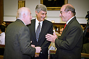 Federal Reserve Chairman Alan Greenspan makes a joke as Secretary of the Treasury Robert Rubin and House Banking Chairman Rep. Jim Leach (L) laugh before the start of hearings May 20, 1999 in Washington, DC.
