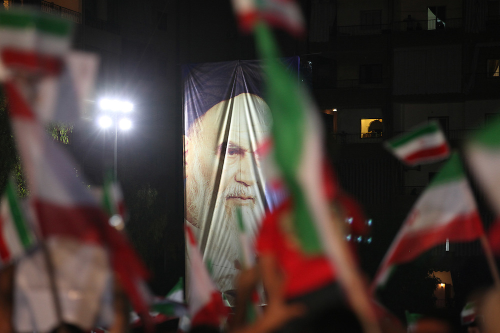 Iranian President Mahmoud Ahmadinejad arrived in Beirut this morning for the start of a two-day trip to Lebanon. After visits around Beirut, Ahmadinejad ended the day by speaking at a Hizballah-organized rally attended by tens of thousands in Beirut's southern suburbs. At the rally, Hizballah head Hassan Nasrallah also addressed the crowd from a video link.///Hizballah supporters attend a rally to welcome Mahmoud Ahmadinejad. They waved Iranian, Lebanese and Hizballah flags, and also help up images of Ahmadinejad, and Iran's revolutionary Ayatollah Khomeini along with his successor, Iran's current Supreme Leader Ayatollah Khamenei.