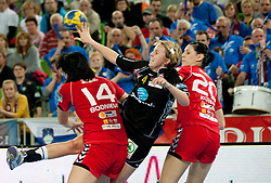Sara Breistol of Larvik betaeen Ljudmila Bodnieva and Alja Koren of Krim during handball match between RK Krim Mercator and Larvik HK (NOR) of Women's EHF Champions League 2011/2012, on November 13, 2011 in Arena Stozice, Ljubljana, Slovenia. (Photo By Vid Ponikvar / Sportida.com)