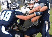 John Glenn's Adam Meyer pushes through the Petoskey defense to score the Bobcat's first touchdown during the third quarter.