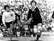 Bruce Robertson (right) chased by Dirk Froneman.<br /> New Zealand All Blacks v Free State.<br /> All Blacks tour to South Africa 1976.<br /> Copyright photo: Wessel Oosthuizen / www.photosport.co.nz