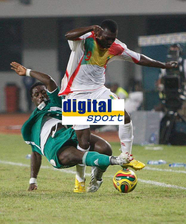 Photo: Steve Bond/Richard Lane Photography.<br />Nigeria v Mali. Africa Cup of Nations. 25/01/2008. Amadou Sidibe (R) is tackled by Obinna Nwaneri (L)