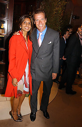 DIVIA LALVANI and JOEL CADBURY at a party to celebrate 100 years of Chinese Cinema hosted by Shangri-la Hotels and Tartan Films at Asprey, New Bond Street, London on 25th April 2006.<br />