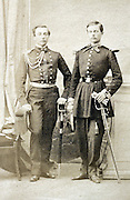 two young adult men posing in military uniform France 1880s