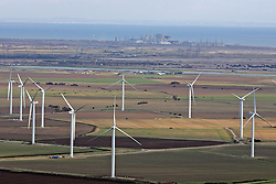 Image &copy;Licensed to i-Images Picture Agency. Aerial views. United Kingdom.<br /> THE WIND FARM ON THE ROMNEY MARSH AND IN THE BACKGROUND IS THE DUNGENESS NUCLEAR POWER STATION. Picture by i-Images