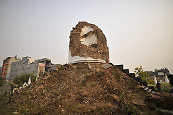 April 25, 2018 - Kathmandu, NE, Nepal - A reminisce part of historic tower Dharahara knocked down on April 25, 2015 Gorkha Earthquake remembered during third anniversary in Kathmandu, Nepal on Wednesday, April 25, 2018. Most of the centuries-old monuments and houses were completely or partially destroyed in the catastrophic 7.8 magnitude earthquake that killed over 9,000 people, leaving thousands injured. (Credit Image: © Narayan Maharjan/NurPhoto via ZUMA Press)