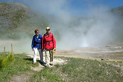 WY: Wyoming; Yellowstone National Park.In Midway Geyser Basin.at Imperial Geyser, hikers, Model Released.Photo #: yellow1508.Photo copyright Lee Foster, 510/549-2202, lee@fostertravel.com, www.fostertravel.com..