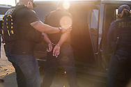 RIVERSIDE, CA | June 22, 2017<br /> The intended target was not home during a pre-dawn raid by agents from U.S. Immigration and Customs Enforcement. After getting permission from the homeowner, officers enter the house to search it. This led to the arrest and eventual deportation of the target's father, Fidel Delgado Rocha.  (Melissa Lyttle for The New York Times)