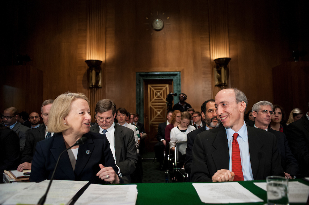 Mary Schapiro, chairman of the Securities and Exchange Commission and Gary Gensler, chairman of the Commodity Futures Trading Commission, confer before a Senate Banking, Housing and Urban Affairs Committee on Tuesday on Captiol Hill. The committee held the hearing about implementing derivatives reform and reducing systemic risk and improving market oversight.