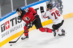 Nate Mackinnon of Canada vs Joel Genazzi of Switzerland during the 2017 IIHF Men's World Championship group B Ice hockey match between National Teams of Canada and Switzerland, on May 13, 2017 in AccorHotels Arena in Paris, France. Photo by Vid Ponikvar / Sportida