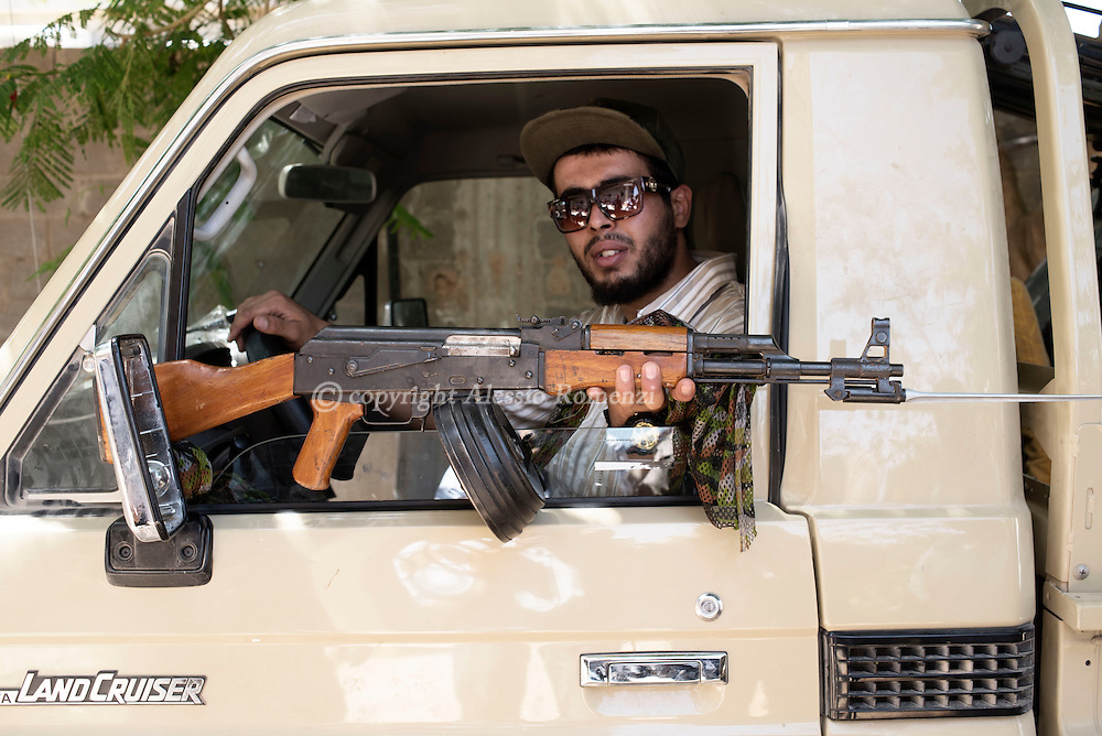 Libya: In Sirte a Libya's Government of National Accord's (GNA)  fighter shows an ak47 rifle he took from a killed ISIS fighter. Alessio Romenzi