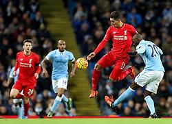 Roberto Firmino of Liverpool is tackled by Eliaquim Mangala of Manchester City - Mandatory byline: Matt McNulty/JMP - 07966 386802 - 21/11/2015 - FOOTBALL - Etihad Stadium - Manchester, England - Manchester City v Liverpool - Barclays Premier League