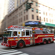 A general view of a moving NYFD fire truck in New York City on Monday, September 28, 2015.  (Alex Menendez via AP)