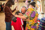 "13 JULY 2012 - FT DEFIANCE, AZ: Pastor ROGER TSOSIE, from the Window Rock Methodist Church, prays with people during the alter call at the 23rd annual Navajo Nation Camp Meeting in Ft. Defiance, north of Window Rock, AZ, on the Navajo reservation. Preachers from across the Navajo Nation, and the western US, come to Navajo Nation Camp Meeting to preach an evangelical form of Christianity. Evangelical Christians make up a growing part of the reservation - there are now more than a hundred camp meetings and tent revivals on the reservation every year. The camp meeting in Ft. Defiance draws nearly 200 people each night of its six day run. Many of the attendees convert to evangelical Christianity from traditional Navajo beliefs, Catholicism or Mormonism. ""Camp meetings"" are a form of Protestant Christian religious services originating in Britain and once common in rural parts of the United States. People would travel a great distance to a particular site to camp out, listen to itinerant preachers, and pray. This suited the rural life, before cars and highways were common, because rural areas often lacked traditional churches.   PHOTO BY JACK KURTZ"