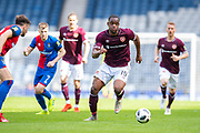 Uche Ikpeazu (#19) of Heart of Midlothian FC chases the ball during the William Hill Scottish Cup semi-final match between Heart of Midlothian and Inverness CT at Hampden Park, Glasgow, United Kingdom on 13 April 2019.