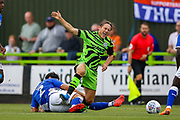 Oldham Athletic defender Zak Mills brings down Forest Green Rovers forward George Williams (11) during the EFL Sky Bet League 2 match between Forest Green Rovers and Oldham Athletic at the New Lawn, Forest Green, United Kingdom on 3 August 2019.