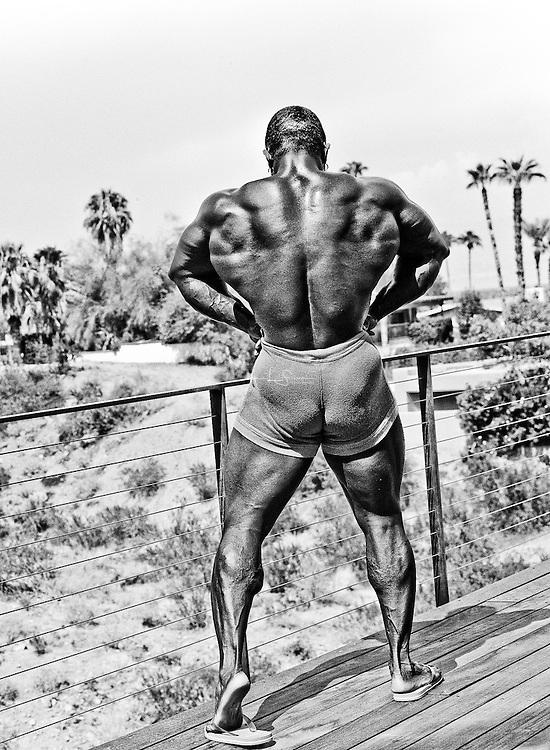 Bodybuilder Sean Jones posing pool side