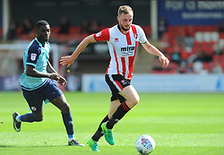 Enzio Boldewijn of Crawley Town applies pressure on Carl Winchester of Cheltenham Town Mandatory by-line: Nizaam Jones/JMP - 12/08/2017 - FOOTBALL - The LCI Rail Stadium - Cheltenham, England - Cheltenham Town v Crawley Town - Sky Bet League Two