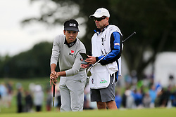 September 8, 2018 - Newtown Square, Pennsylvania, United States - Kevin Na (L) and his caddie Kevin Harms wait on the 16th green during the third round of the 2018 BMW Championship. (Credit Image: © Debby Wong/ZUMA Wire)