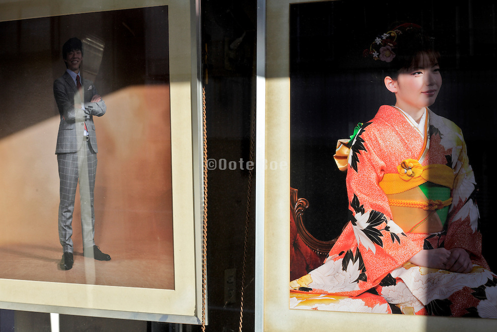 young adult boy and girls portrait in window display of photography portrait studio and store Yokosuka Japan