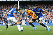 Wolverhampton Wanderers defender Ruben Vinagre (29) goes between Everton midfielder Andre Gomes (21) and Everton defender Seamus Coleman (23) during the Premier League match between Everton and Wolverhampton Wanderers at Goodison Park, Liverpool, England on 1 September 2019.