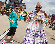 """Artist and designer of """"A Piece of Panama"""" Nicoletta Brown dances with a festival attendee during Artscape in Baltimore, MD on Sunday, July 21, 2013."""