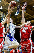 21 November 2009: Duke Junior Forward #12 Kyle Singler drives hard to the basket aginst Radford (45) Artsiom Parakhouski senior center..Duke Rolls Past Radford 104-67 .Mandatory Credit: Mark Abbott / Southcreek Global