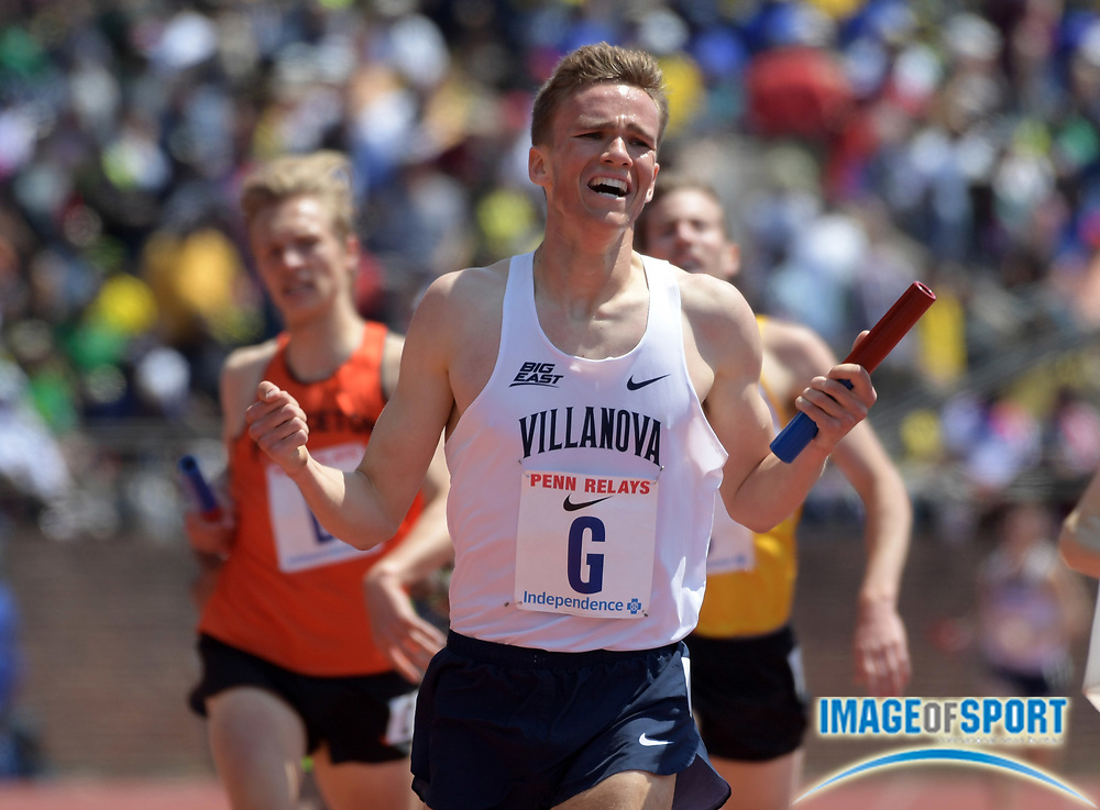 Apr 28, 2018; Philadelphia, PA, USA; Casey Comber celebrates after running anchor leg on the Villanova 4 x mile relay that won the Championship of America race in 16:23.75 during the 124th Penn Relays at Franklin Field.